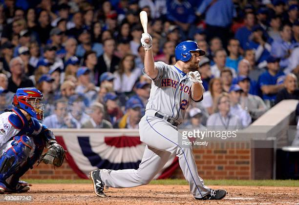 Daniel Murphy of the New York Mets doubles in the top of the seventh inning of Game 4 of the NLCS against the Chicago Cubs at Wrigley Field on...