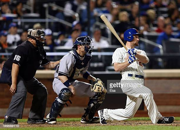 Daniel Murphy of the New York Mets drives in the game winning run in the eighth inning as Chris Stewart of the New York Yankees catches on May 27...
