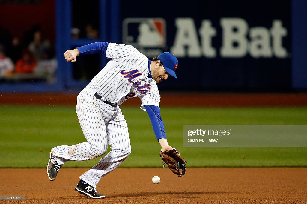 Daniel Murphy #28 of the New York Mets fails to make a play on a ball hit by Eric Hosmer #35 of the Kansas City Royals in the eight inning of Game Four of the 2015 World Series at Citi Field on October 31, 2015 in the Flushing neighborhood of the Queens borough of New York City.