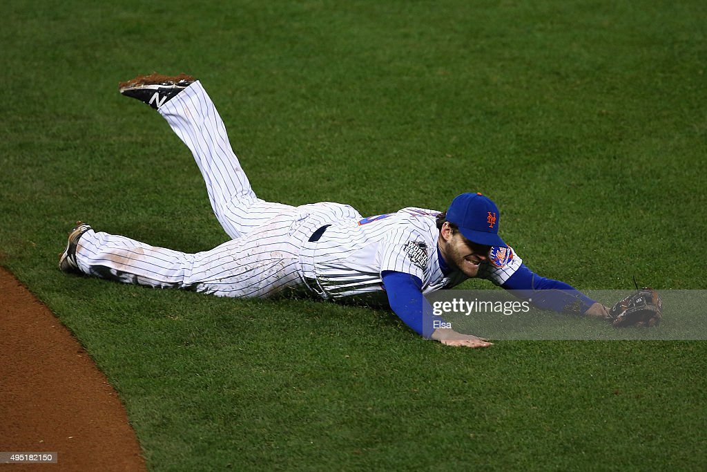 Daniel Murphy of the New York Mets fails to make a play on a ball hit by Mike Moustakas of the Kansas City Royals in the eight inning of Game Four of...