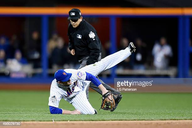 Daniel Murphy of the New York Mets fails to make the play during Game 3 of the 2015 World Series against the Kansas City Royals at Citi Field on...