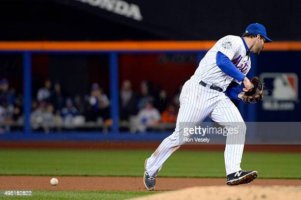 Daniel Murphy of the New York Mets fails to make the play on a Eric Hosmer of the Kansas City Royals slow roller during Game 4 of the 2015 World...