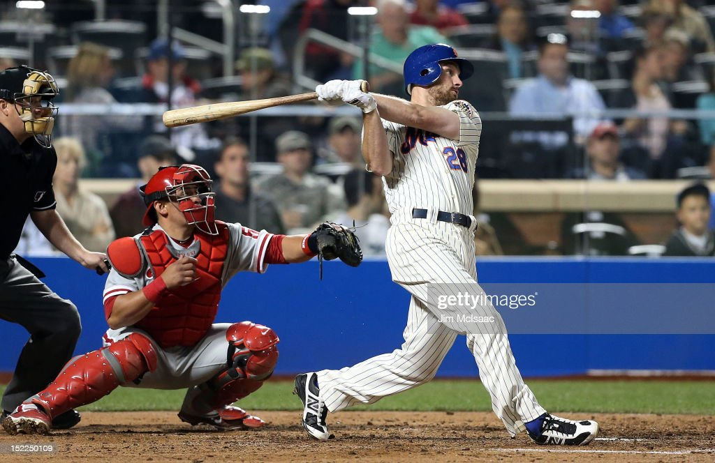 Daniel Murphy #28 of the New York Mets follows through on a fifth inning RBI single against the Philadelphia Phillies at Citi Field on September 17, 2012 in the Flushing neighborhood of the Queens borough of New York City.