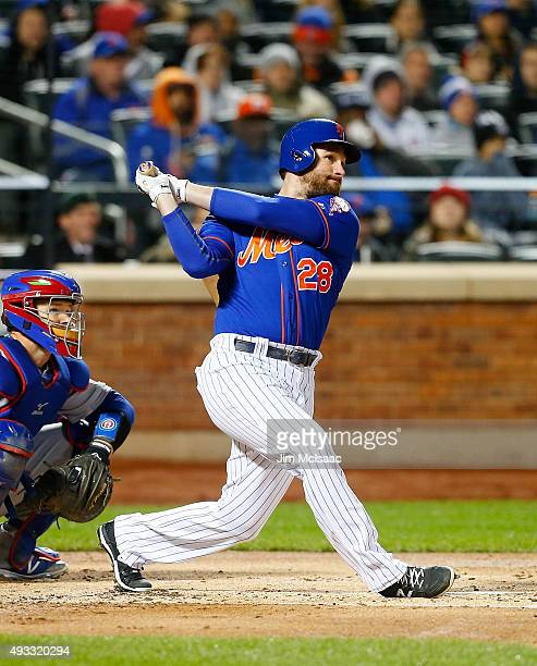Daniel Murphy of the New York Mets follows through on a first inning home run against the Chicago Cubs during game one of the 2015 MLB National...