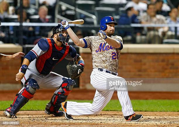 Daniel Murphy of the New York Mets follows through on a seventhinning tworun double against the Atlanta Braves at Citi Field on September 21 2015 in...