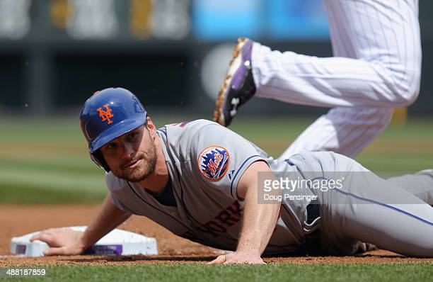 Daniel Murphy of the New York Mets gets caught in a double play at third base on a fly ball by Chris Young of the New York Mets to left fielder...