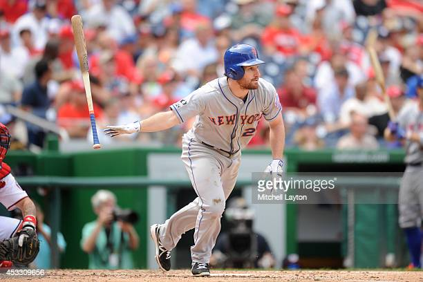 Daniel Murphy of the New York Mets gets one of his three hits in the sixth inning during a baseball game against the Washington Nationals on August 7...