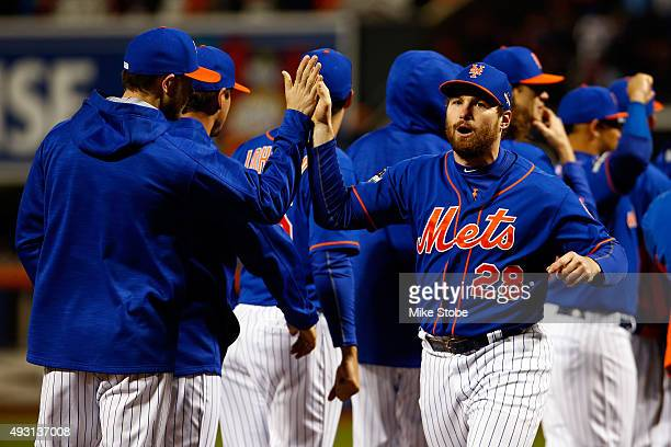 Daniel Murphy of the New York Mets highfives during player introductions prior to game one of the 2015 MLB National League Championship Series...