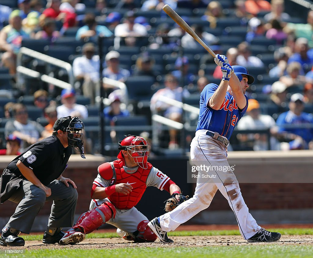 Daniel Murphy #28 of the New York Mets hits a double and knocks in a run in the third inning against the Philadelphia Phillies on August 29, 2013 at Citi Field in the Flushing neighborhood of the Queens borough of New York City. The Mets defeated the Phillies 11-3.