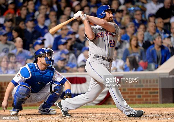 Daniel Murphy of the New York Mets hits a home run in the top of the third inning of Game 3 of the NLCS against the Chicago Cubs at Wrigley Field on...