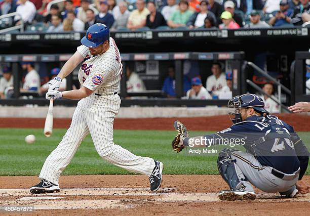 Daniel Murphy of the New York Mets hits a single in the first inning against the Milwaukee Brewers during the game at Citi Field on June 11 2014 in...