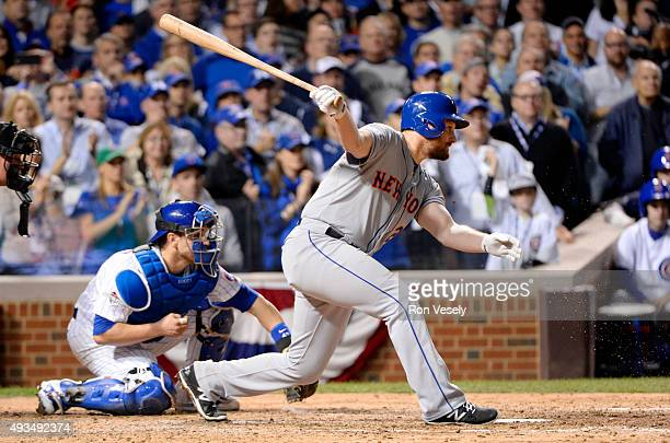 Daniel Murphy of the New York Mets hits a single in the seventh inning during Game 3 of the NLCS against the Chicago Cubs at Wrigley Field on Tuesday...