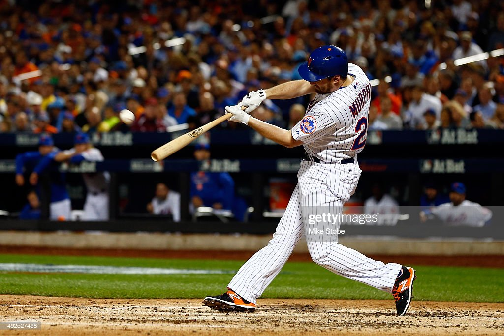 Daniel Murphy #28 of the New York Mets hits a solo home run against Clayton Kershaw #22 of the Los Angeles Dodgers in the fourth inning during game four of the National League Division Series at Citi Field on October 13, 2015 in New York City.