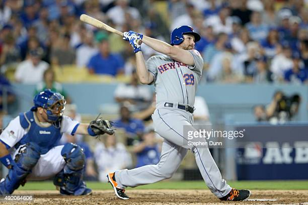 Daniel Murphy of the New York Mets hits a solo home run in the fourth inning against the Los Angeles Dodgers in game one of the National League...