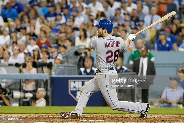 Daniel Murphy of the New York Mets hits a solo home run in the sixth inning against the Los Angeles Dodgers in game five of the National League...