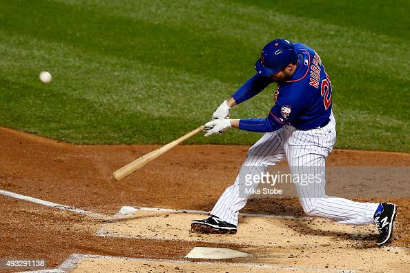 Daniel Murphy of the New York Mets hits a two run home run in the first inning against Jake Arrieta of the Chicago Cubs during game two of the 2015...