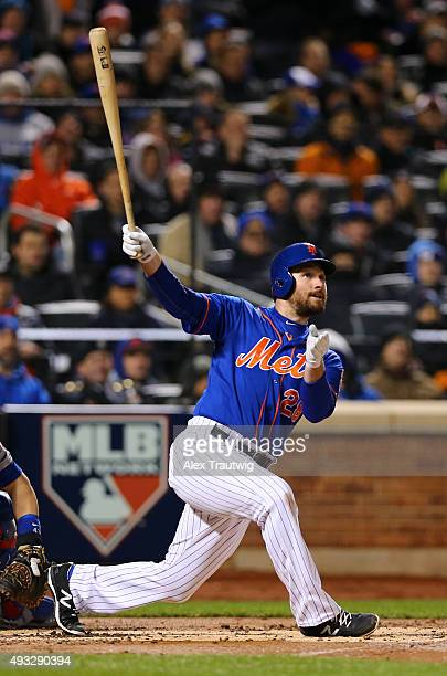 Daniel Murphy of the New York Mets hits a tworun home run in the first inning of Game 2 of the NLCS against the Chicago Cubs at Citi Field on Sunday...