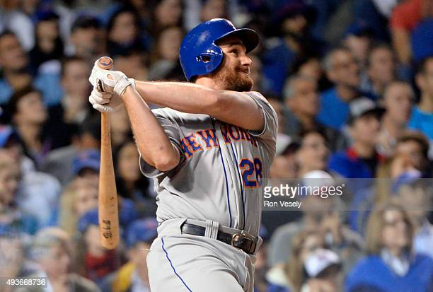 Daniel Murphy of the New York Mets hits a tworun home run in the top of the eighth inning of Game 4 of the NLCS against the Chicago Cubs at Wrigley...