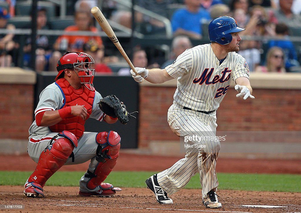 Daniel Murphy #28 of the New York Mets hits an RBI double as catcher Carlos Ruiz #51 of the Philadelphia Phillies looks on in the second inning at Citi Field on July 3, 2012 in the Flushing neighborhood of the Queens borough of New York City.