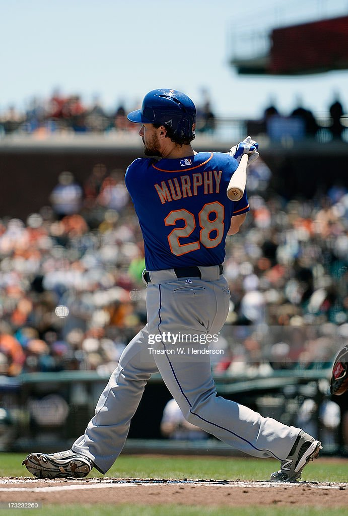 Daniel Murphy #28 of the New York Mets hits an RBI single scoring Eric Young #22 in the first inning against the San Francisco Giants at AT&T Park on July 10, 2013 in San Francisco, California.