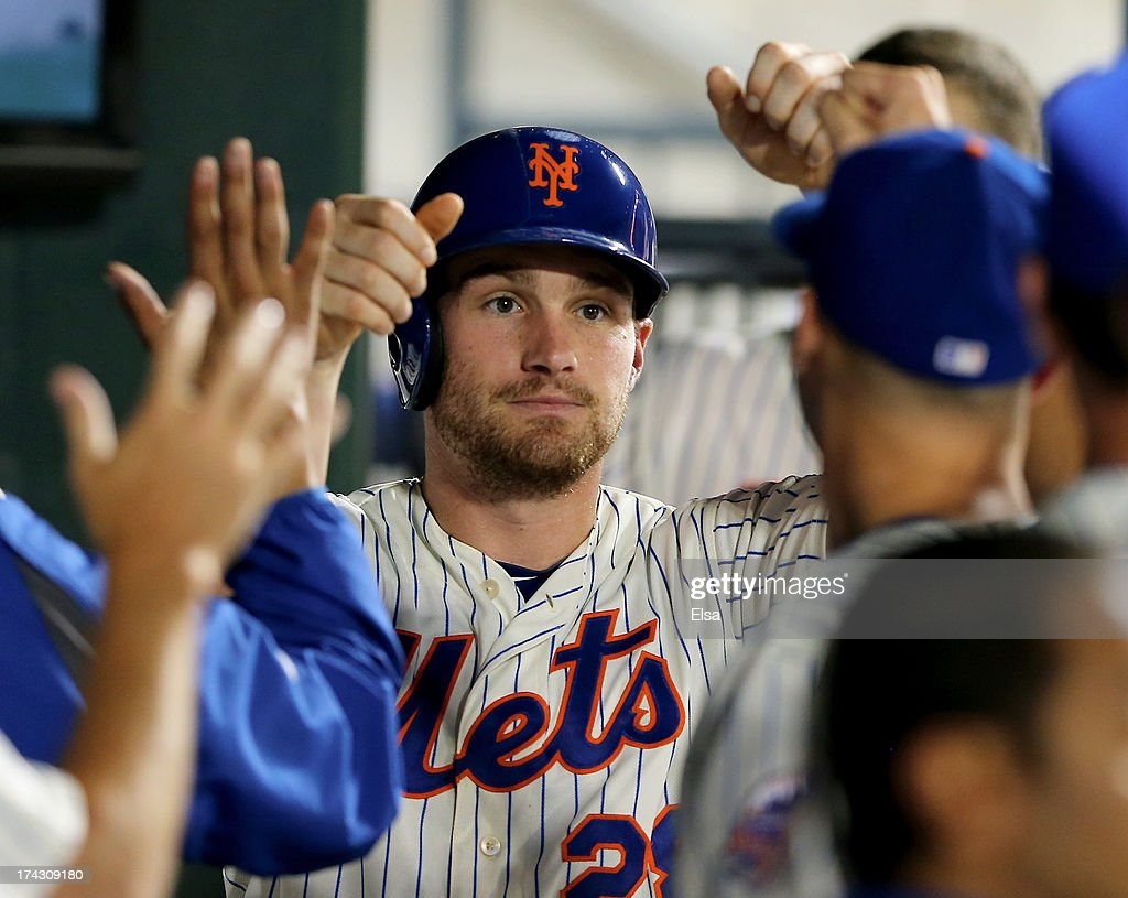 Daniel Murphy #28 of the New York Mets is congratulated after he scored a run in the sixth inning against the Atlanta Braves on July 23, 2013 at Citi Field in the Flushing neighborhood of the Queens borough of New York City.