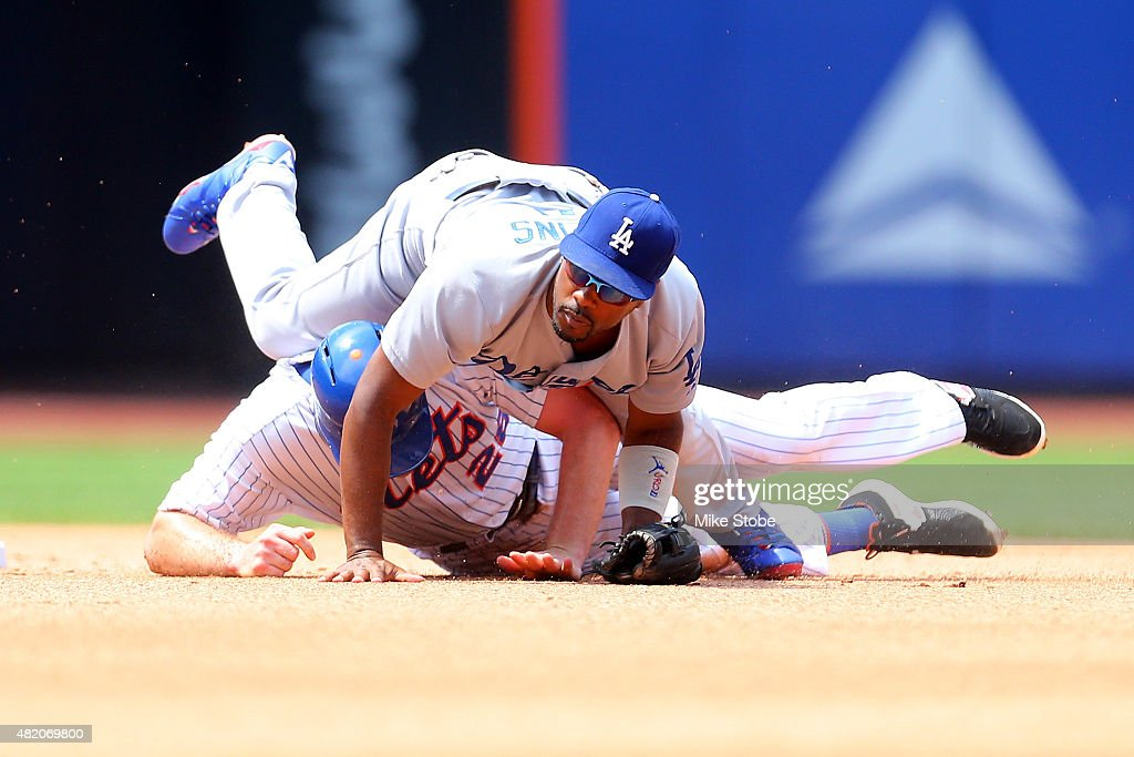 Daniel Murphy of the New York Mets is forced out at second as Jimmy Rollins of the Los Angeles Dodgers completes the double play at Citi Field on...