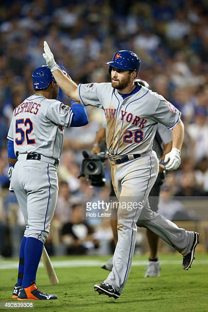 Daniel Murphy of the New York Mets is greeted by teammate Yoenis Cespedes after hitting a home run during Game 5 of the NLDS against the Los Angeles...