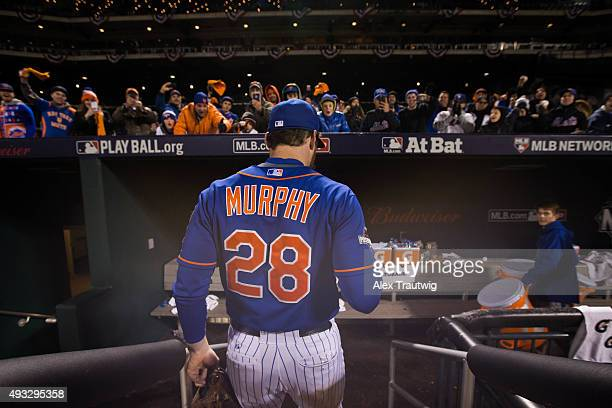 Daniel Murphy of the New York Mets is seen entering the dugout after defeating the Chicago Cubs in Game 2 of the NLCS at Citi Field on Sunday October...
