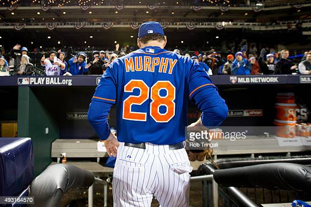 Daniel Murphy of the New York Mets is seen heading into the dugout after defeating the Chicago Cubs in Game 1 of the NLCS at Citi Field on Saturday...