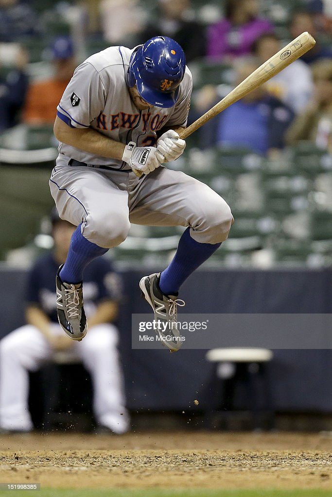 Daniel Murphy #28 of the New York Mets jumps out of the way of a pitch by TylerThornberg of the Milwaukee Brewers during the top of the 9th inning at Miller Park on September 14, 2012 in Milwaukee, Wisconsin.