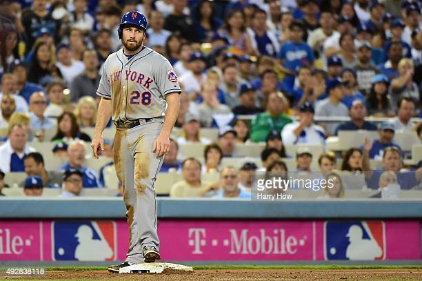 Daniel Murphy of the New York Mets looks on from third base after advancing as the base was not covered by a Los Angeles Dodgers player in the fourth...