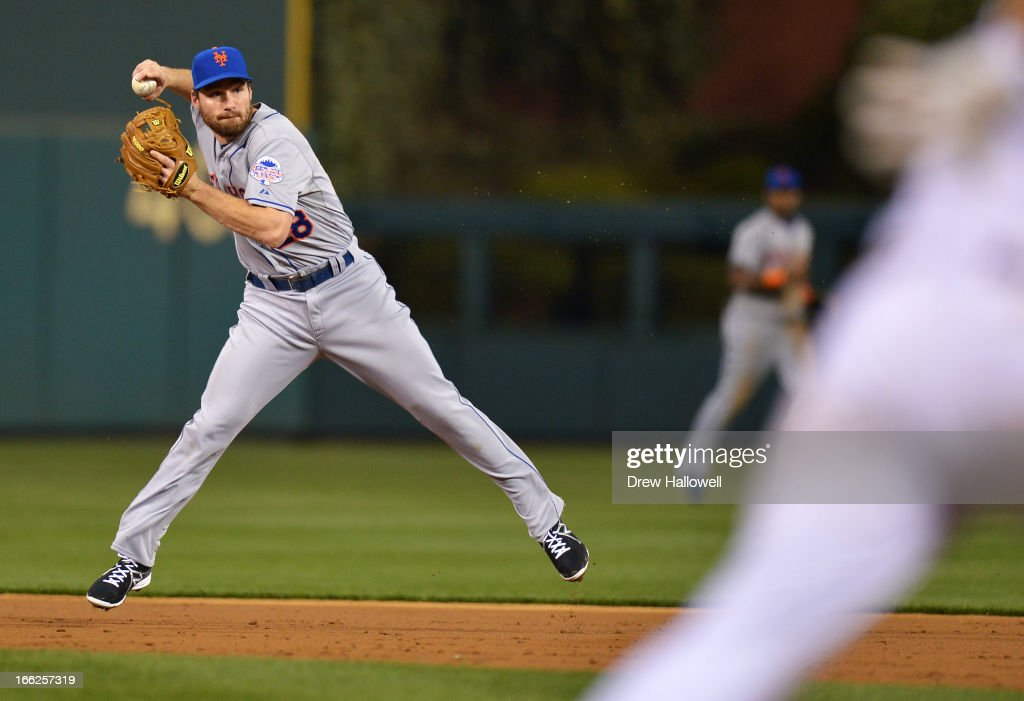Daniel Murphy #28 of the New York Mets makes a throw to first base to put out <a gi-track='captionPersonalityLinkClicked' href=/galleries/search?phrase=Ben+Revere&family=editorial&specificpeople=6826641 ng-click='$event.stopPropagation()'>Ben Revere</a> #2 of the Philadelphia Phillies in the second inning at Citizens Bank Park on April 10, 2013 in Philadelphia, Pennsylvania.