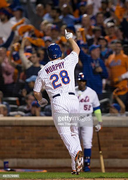 Daniel Murphy of the New York Mets points to the sky after hitting a home run during Game 4 of the NLDS against the Los Angeles Dodgers at Citi Field...