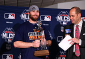 Daniel Murphy of the New York Mets poses with the NLCS MVP trophy after defeating the Chicago Cubs in game four of the 2015 MLB National League...
