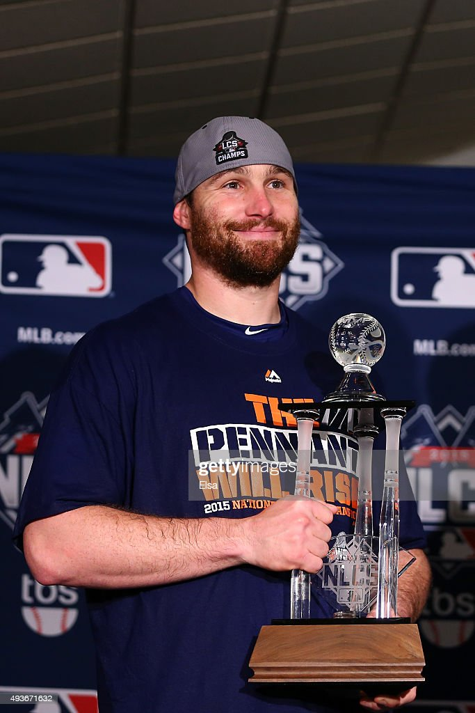 Daniel Murphy #28 of the New York Mets poses with the NLCS MVP trophy after defeating the Chicago Cubs in game four of the 2015 MLB National League Championship Series at Wrigley Field on October 21, 2015 in Chicago, Illinois. The Mets defeated the Cubs with a score of 8 to 3 to sweep the Championship Series.