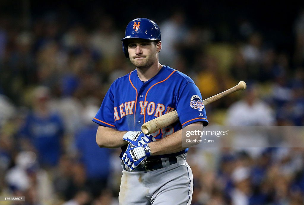 Daniel Murphy #28 of the New York Mets reacts after being called out on strikes to end the top of the eighth inning against the Los Angeles Dodgers at Dodger Stadium on August 13, 2013 in Los Angeles, California.