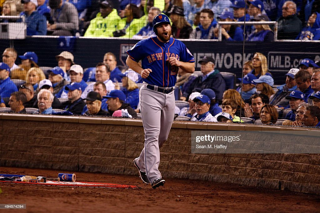 Daniel Murphy #28 of the New York Mets reacts after scoring a run on an RBI single hit by Travis d'Arnaud #7 of the New York Mets (not pictured) in the fourth inning against the Kansas City Royals during Game One of the 2015 World Series at Kauffman Stadium on October 27, 2015 in Kansas City, Missouri.
