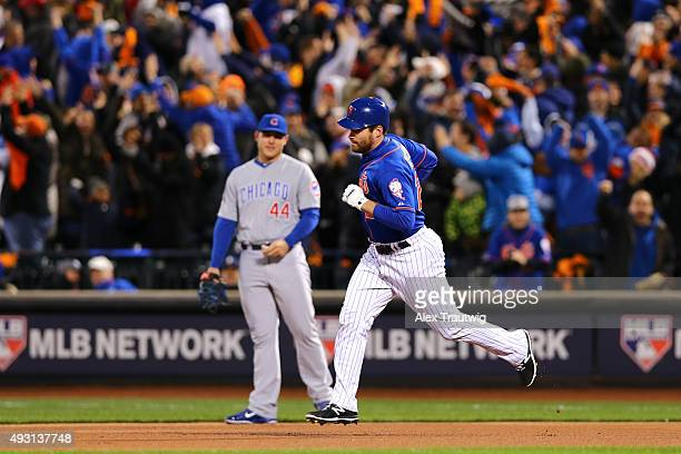 Daniel Murphy of the New York Mets rounds the bases after hitting a home run in the first inning of Game 1 of the NLCS against the Chicago Cubs at...
