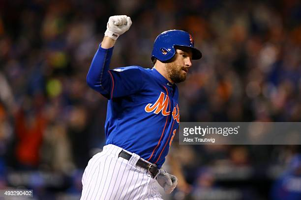 Daniel Murphy of the New York Mets rounds the bases after hitting a tworun home run in the first inning of Game 2 of the NLCS against the Chicago...