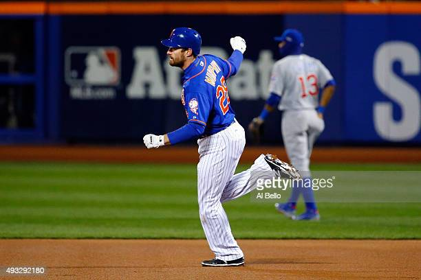 Daniel Murphy of the New York Mets rounds the bases after hitting a two run home run in the first inning against Jake Arrieta of the Chicago Cubs...