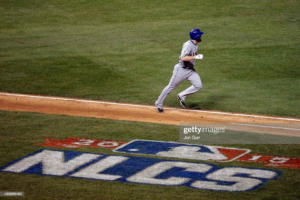 Daniel Murphy of the New York Mets rounds the bases after hitting a two run home run in the eighth inning against Fernando Rodney of the Chicago Cubs...
