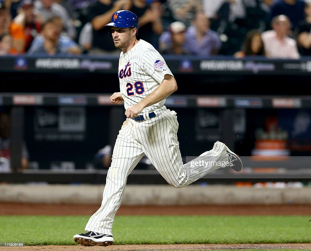 Daniel Murphy #28 of the New York Mets scores a run in the sixth inning against the Atlanta Braves on July 23, 2013 at Citi Field in the Flushing neighborhood of the Queens borough of New York City.
