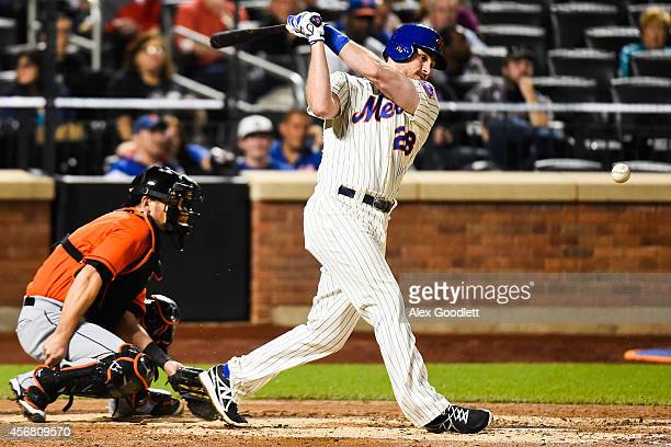 Daniel Murphy of the New York Mets swings at a pitch during a game against the Miami Marlins at Citi Field on September 17 2014 in the Flushing...