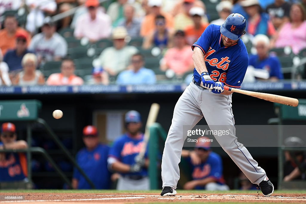 Daniel Murphy of the New York Mets swings at a pitch during the second inning of a spring training game against the Miami Marlin at Roger Dean...