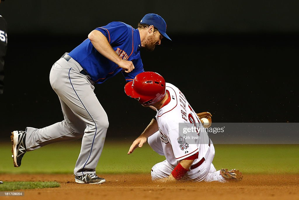 Daniel Murphy #28 of the New York Mets tags out <a gi-track='captionPersonalityLinkClicked' href=/galleries/search?phrase=Todd+Frazier&family=editorial&specificpeople=4778756 ng-click='$event.stopPropagation()'>Todd Frazier</a> #21 of the Cincinnati Reds at second base at Great American Ball Park on September 23, 2013 in Cincinnati, Ohio. Cincinnati defeated New York 3-2 in 10 innings.