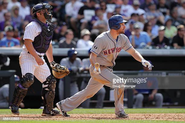 Daniel Murphy of the New York Mets takes an at bat as catcher Michael McKenry of the Colorado Rockies backs up the plate at Coors Field on May 4 2014...