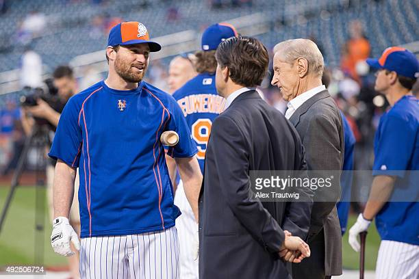 Daniel Murphy of the New York Mets talks to New York Mets owners Fred and Jeff Wilspon during batting practice before Game 4 of the NLDS against the...