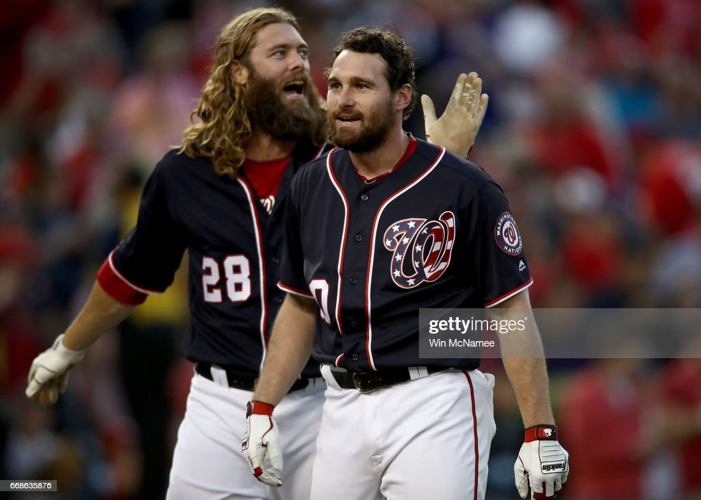 Daniel Murphy #20 of the Washington National is congratulated by teammate Jayson Wert #28 after Murphy hit a game winning double in the tenth inning against the Philadelphia Phillies on April 14, 2017 at Nationals Park in Washington, DC. The Nationals won the game 3-2.