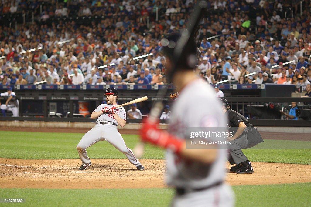 Daniel Murphy of the Washington Nationals avoids a pitch from Antonio Bastardo of the New York Mets as Bryce Harper of the Washington Nationals waits...