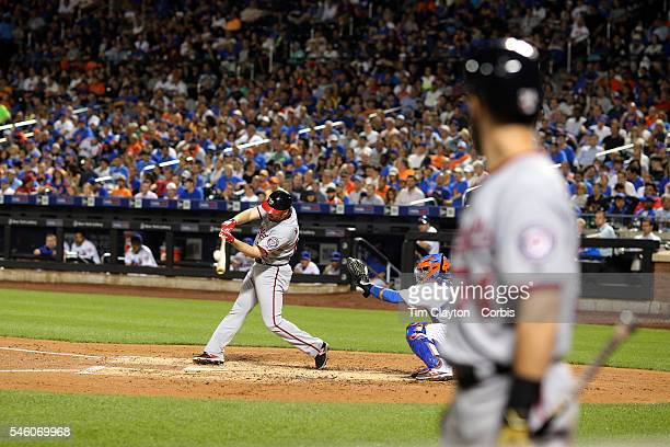 Daniel Murphy of the Washington Nationals batting watched by Bryce Harper of the Washington Nationals on deck during the Washington Nationals Vs New...